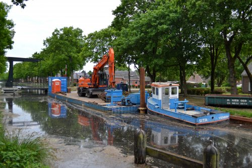 Foto van een Doosan DX190W (kraan) Vegter waterbouw Veendam. Aanleg beschoeiing Burgemeester Beinsdorp bij Ter-Apel