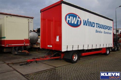Op deze foto staat Henk Wind Transport B.V. (Ter Apelkanaal) × met een Krone aanhangwagen, opgebouwd als zeilenwagen.