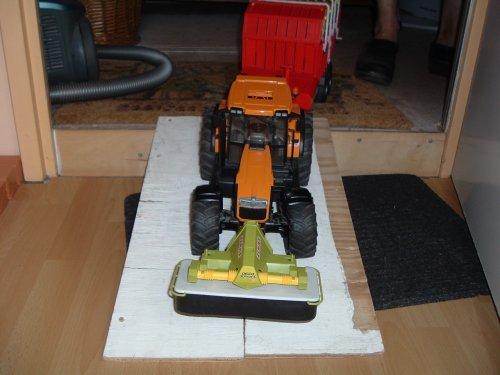 Landbouw miniaturen 1:16 Renault Tapeta