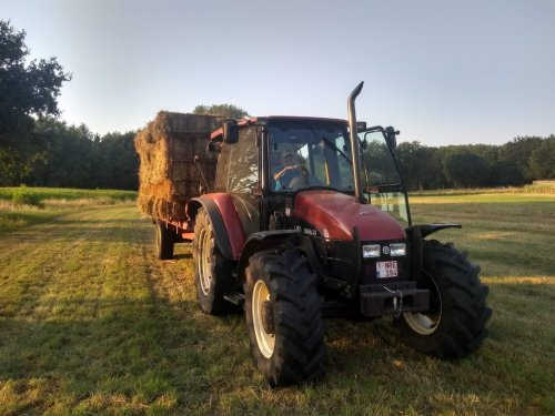 New Holland L 85 van case en international 1455xl