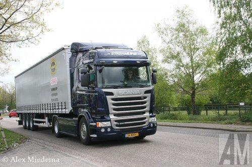 Foto van een Scania R450, opgebouwd als zeilenwagen.. Geplaatst door Alex Miedema op 17-04-2014 om 19:00:35, op TractorFan.nl - de nummer 1 tractor foto website.